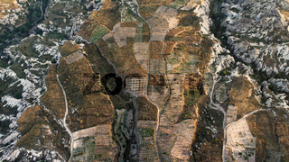Aerial view of small vegetable fields between the craggy cliffs of Cappadocia, Anatolia, Turkey