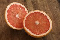 Fresh cut pink grapefruit halves