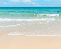 Clear azure sea and sandy beach