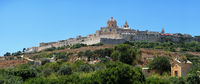 Panorama of Mdina's St. Paul's Cathedral from the countryside below, Malta