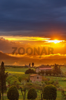Sunset over a farmhouse in Tuscany, Italy