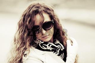 Sad fashion woman in sunglasses outdoor