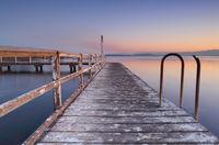 Whitewashed jetty at dusk