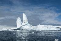 large iceberg in Antarctic waters against the backdrop of the Antarctic Peninsula