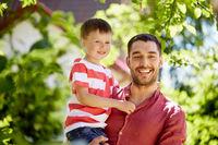 happy father and son at summer garden