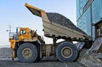 BELAZ-75131 mining dump truck discharging a load of copper ore, Erdenet Mining Corporation EMC