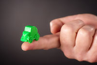 Finger with little green car