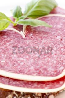 Heart-shaped salami on farmhouse bread as closeup