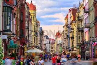 Crowded pedestrian street in european town Torun, Poland