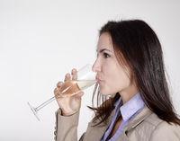 businesswoman drinking champagne