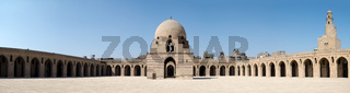Panorama of the courtyard of Ibn Tulun Mosque, Cairo, Egypt, featuring the ablution fountain and the minaret