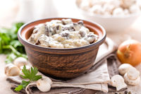 Mushrooms in creamy sauce, julienne. Champignon