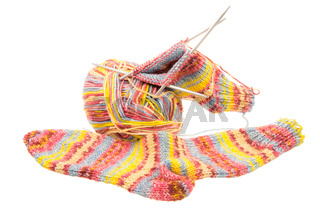 Isolated woolen socks with knitting equipment