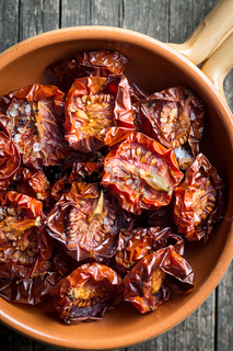 Tasty dried tomatoes in bowl.