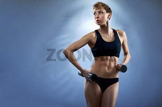 Young attractive fitness woman wearing black sportswear