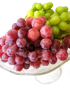 green and red grapes on tray isolated