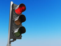 Traffic light with red color on blue sky background. Stop concept.