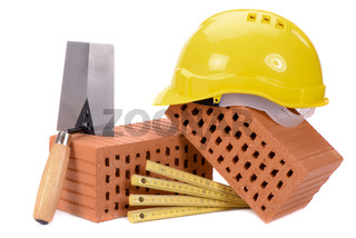 brick for house construction and tools isolated over white background