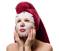 girl with a sheet cosmetic paper mask on her face white background