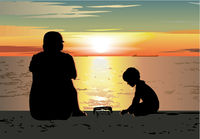 Father and son sitting on the beach, watching sunset