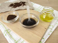 Body soap scrub from dried used coffee grounds and olive oil