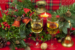 Two glasses of wine on a decorated christmas table