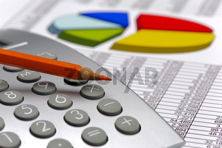 calculator and pencil laying on financial business chart
