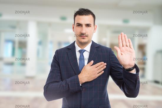 Honest trustworthy real estate agent making oath swear vow gesture