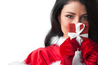 Woman in santa clothes with gift