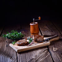 Grilled lamb chops  an old board