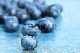 Blueberries on blue background