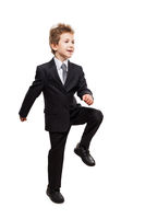 Smiling businessman child boy walking for next achievement step