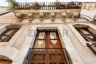 facade of baroque style urban house in syracuse