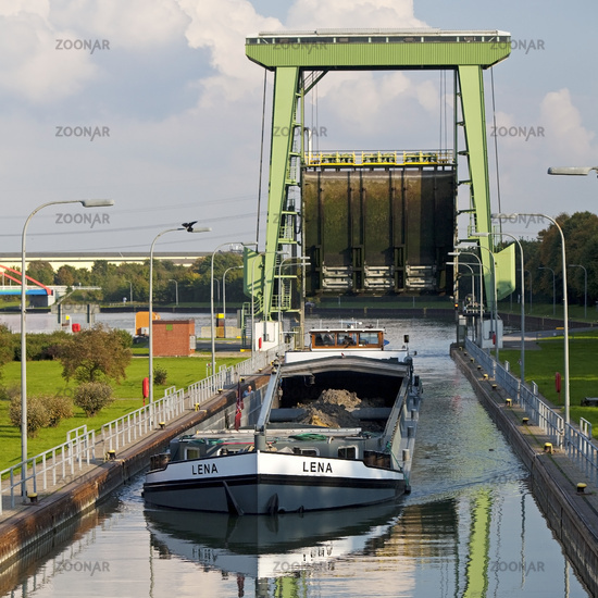 big watergate Friedrichsfeld with freighter, Wesel-Datteln-Kanal, Voerde, Ruhr Area, Germany, Europe