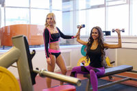 Image of girlfriends exercising in fitness room
