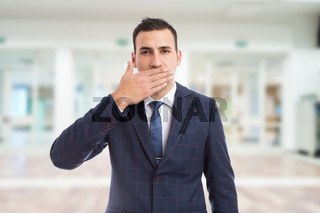 Salesman realtor or real estate agent covering his mouth