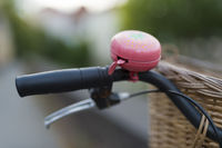 Bicycle handlebars with pink bell