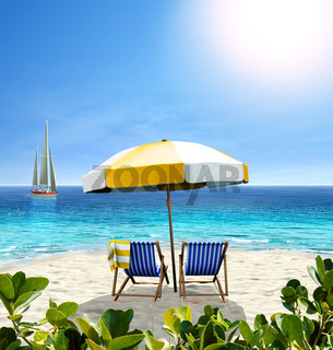 Beautiful beach with white sand, two chairs, umbrella and a sailing boat in the sea.