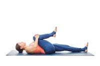 Woman doing Yoga asana Ardha pawanmuktasana isolated