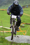 Biker jump on dirty downhill race