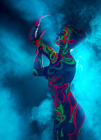 Nightclub dancer posing nude with glowing body art
