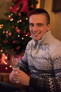 Happy young man with a glass of champagne
