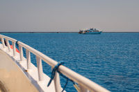 tourists boat anchored in red sea