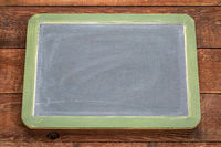 blank slate blackboard against rustic wood