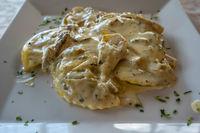Tortelloni cream and mushrooms close up view
