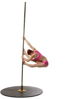 Pole dance. Redhead woman exercising on pylon
