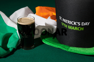 St Patrick day with a pint of black beer, hat and irish flag