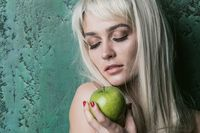 Blonde woman with apple