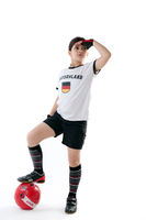 Young girl in soccer clothing with Germany shirt holding a football