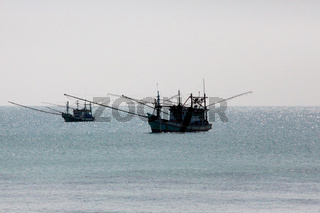 Two Old Rusty Fishing Ships Moored Offshore On Calm Waters